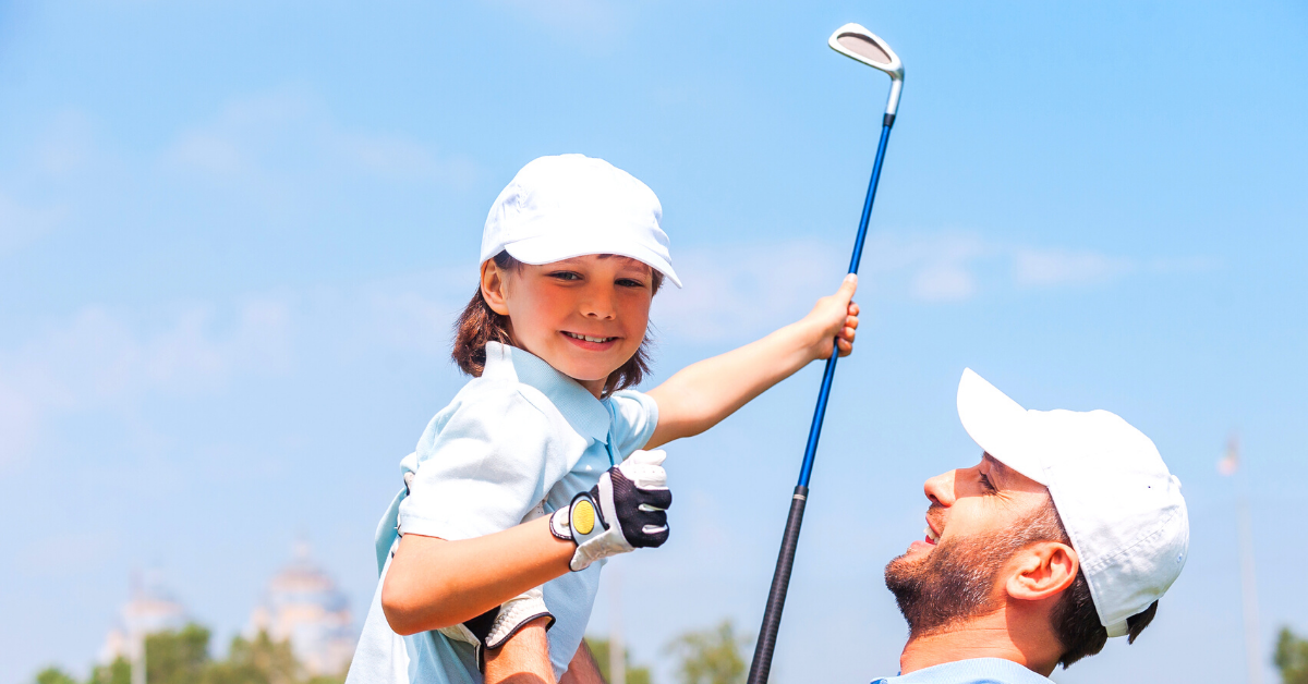 A person and a child playing golf Description automatically generated with low confidence